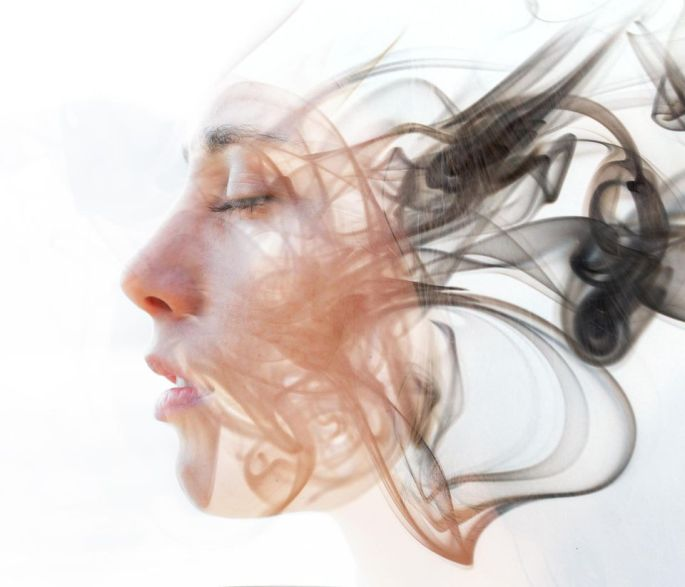 1085790-double-exposure-portrait-of-a-young-fair-skinned-woman-and-a-smoky-texture-dissolving-into-her-facia